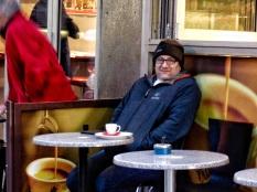 Man outside cafe