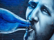 Man with bottle mural