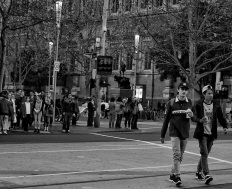 Two boys crossing Flinders St