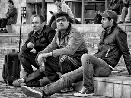 Three men on steps